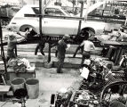 Assembly Line workers in automobile factory