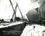 A.O. Smith loading tanks in Winter