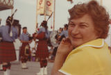 Woman watching Bagpipe band