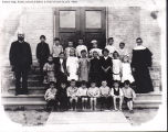Father Vogt, nun, school children in front of new Holy Trinity Church, Kewaskum, Wisconsin, 1906
