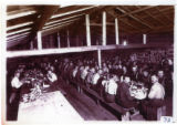 Loggers in mess hall, 1900-1920