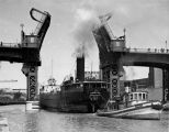 Cargo ship ANGELINE being tugged out of the Port of Milwaukee by the W. H. MEYER