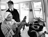 Sister Angelo Seqouia with Captain and Pilot Ruben Jameson aboard the excursion boat the EMERALD...