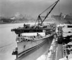 Salvage operation of a converted aircraft carrier in Milwaukee