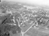 Aerial view of whole town of Oconto Falls (Wis.), including paper mill