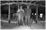 Two farmers in round barn