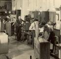 Niss Furniture Workers assembling furniture